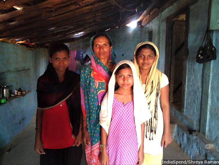 Jijabai Gawli, 40, with three of her daughters. Gawli cultivates a 10-acre piece of land that her husband owned. After his death seven years ago, the farm was transferred to her mother-in-law and sister-in-law. She says she could have secured her children's future had she owned a piece of the land.