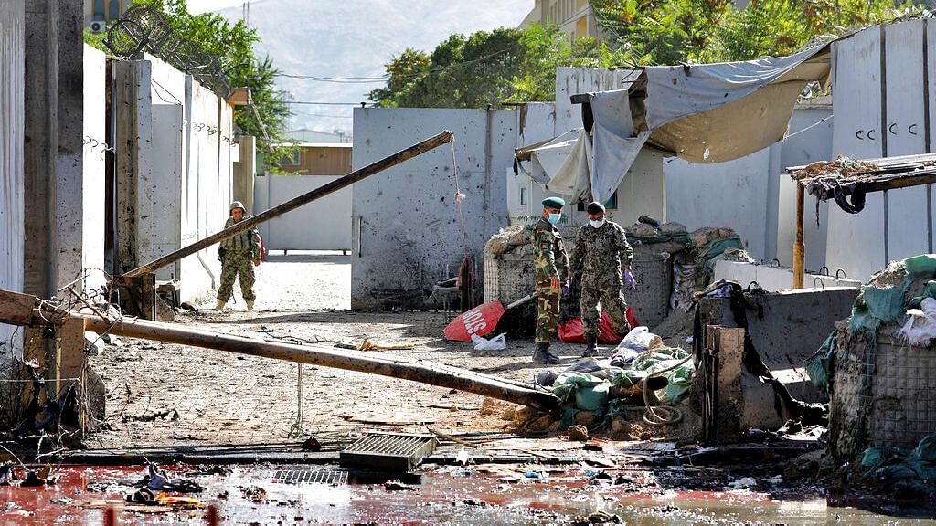 Afghan security forces work at the site of a suicide attack near the US Embassy in Kabul in Afghanistan on 17 September.