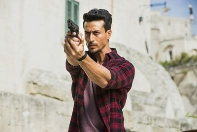 """Actor Tiger Shroff is thrilled about joining forces with his idol Hrithik Roshan in """"War"""". The actors are pitted against each other in the action extravaganza, and Tiger sees their characters as beloved superheroes Superman and Batman."""