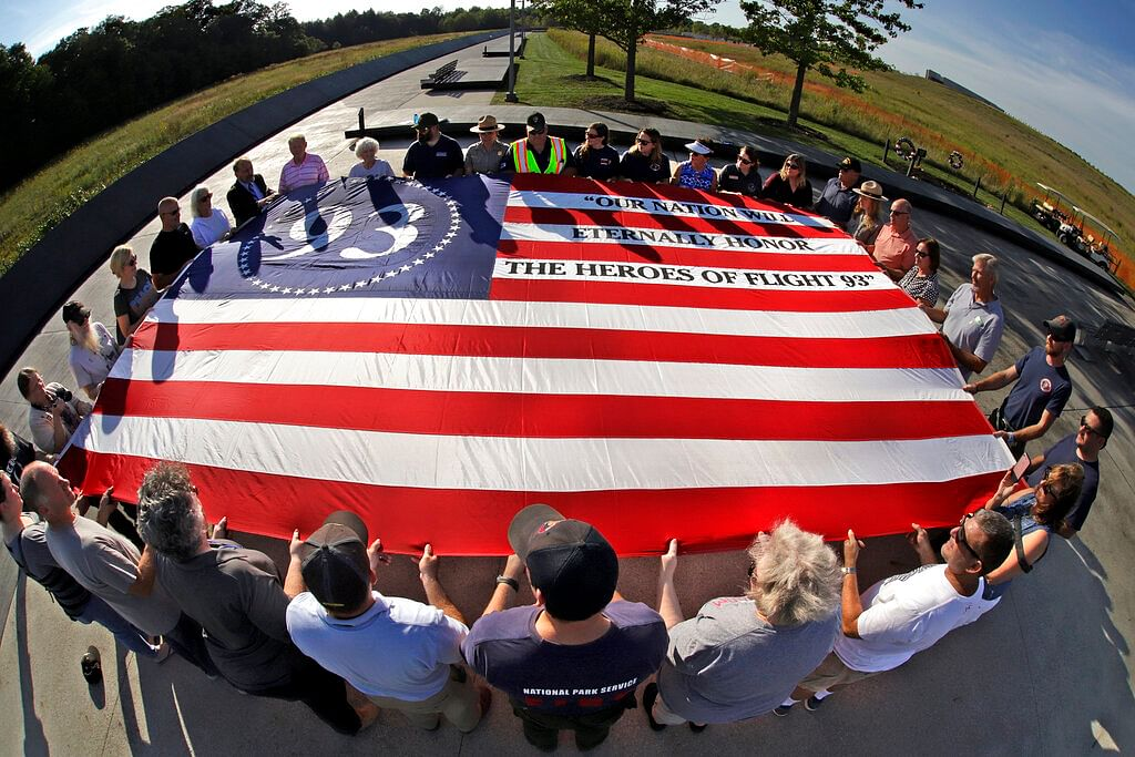 Visitors to the Flight 93 National Memorial in Shanksville, participate in a sunset memorial service on Tuesday, 10 September.