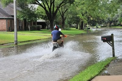 HOUSTON, Aug. 30, 2017 (Xinhua) -- A motorist drives on a waterlogged street in southwest Houston, the United States, on Aug. 29, 2017. Tropical storm Harvey has broken the record of rainfall from a cyclonic storm in the U.S. mainland, with 132 centimeters of rain observed in the state of Texas, authorities said on Tuesday. (Xinhua/Liu Liwei/IANS)