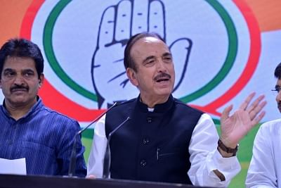 New Delhi: Congress general secretary in-charge of Haryana Ghulam Nabi Azad addresses a press conference in New Delhi on Sep 4, 2019. Also seen Congress general secretary organisation K C Venugopal. (Photo: IANS)