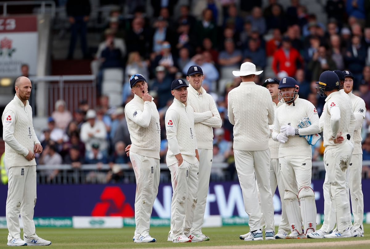 England's players watch a replay after a no ball decision overturned the dismissal of Australia's Steve Smith during day two of the fourth Ashes Test cricket match between England and Australia at Old Trafford in Manchester, England, Thursday, Sept. 5, 2019.