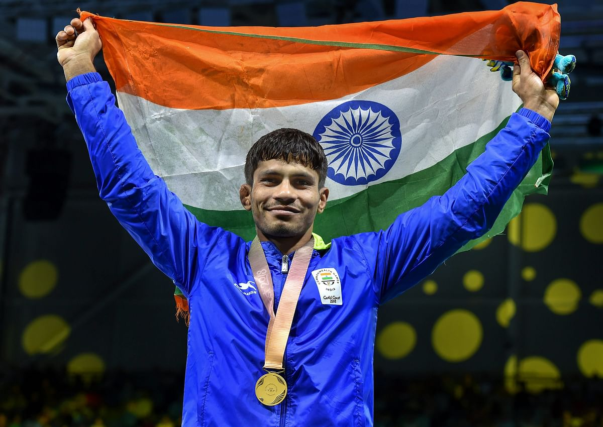 Gold medalist India's Rahul Aware holds the tricolour after the medal ceremony of the men's freestyle 57kg wrestling event at the Commonwealth Games 2018 in Gold Coast.