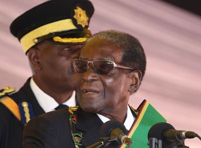 HARARE, Aug. 14, 2017 (Xinhua) -- Zimbabwean President Robert Mugabe (Front) delivers a speech during the Heroes Day commemoration at National Heroes Acre in Harare, Zimbabwe, on Aug. 14, 2017. In an address to mark this year