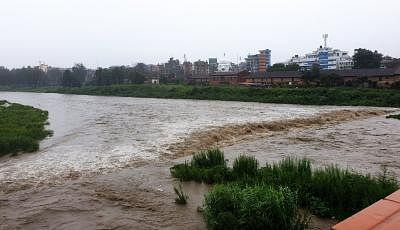 KATHMANDU, July 12, 2019 (Xinhua) -- Photo taken on July 12, 2019 shows the swollen Bagmati river after heavy rainfall in Kathmandu, Nepal. Heavy rains leave Nepalese people at risks of floods and landslides during Monsoon season. Meteorological Forecasting Division under Department of Hydrology and Meteorology (DHM) has issued an alert warning for the next 24 hours across the country after heavy rainfall started from Thursday evening. (Xinhua/Sunil Sharma/IANS)