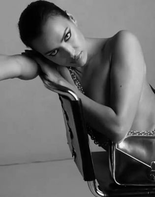 Supermodel Irina Shayk has ditched her clothes and bared it all for a new campaign of a fashion brand. The 33-year-old model went nude in a new campaign to promote Calvin Klein handbags.