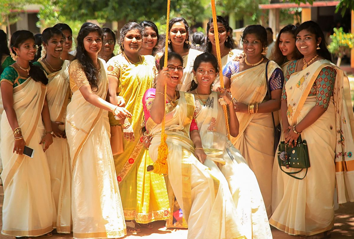 Students pose near a swing during Onam celebrations, in Nagercoil of Kanyakumari district, Tuesday, 10 September. As Kerala gets into the festive mood, police are maintaining tight vigil with the army receiving information that there may be a terror attack in southern parts of the country.