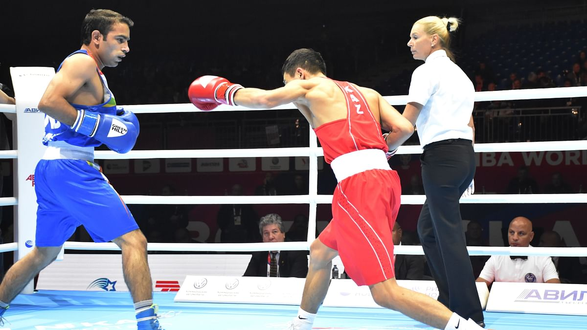 Amit Panghal in action against Kazakhstan's Saken Bibossinov in men's 52 kg semi-final.