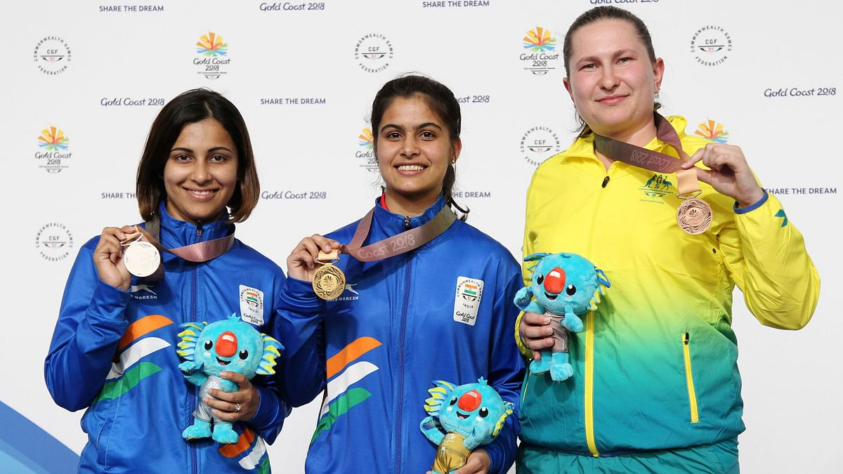 Gold medallist Manu Bhaker of India, silver medallist Heena Sidhu of India and bronze medalist Elena Galiabovitch pose with their medals after the 10m Air Pistol medal ceremony at the 2018 Commonwealth Games.