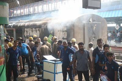 New Delhi: Firefighting operations underway at the New Delhi railway station where a fire broke out in the rear power car of the Chandigarh-Kochuvalli Express, on Sep 6, 2019. No one was injured in the incident that took place at 1.40 p.m. at platform No. 8. (Photo: IANS)