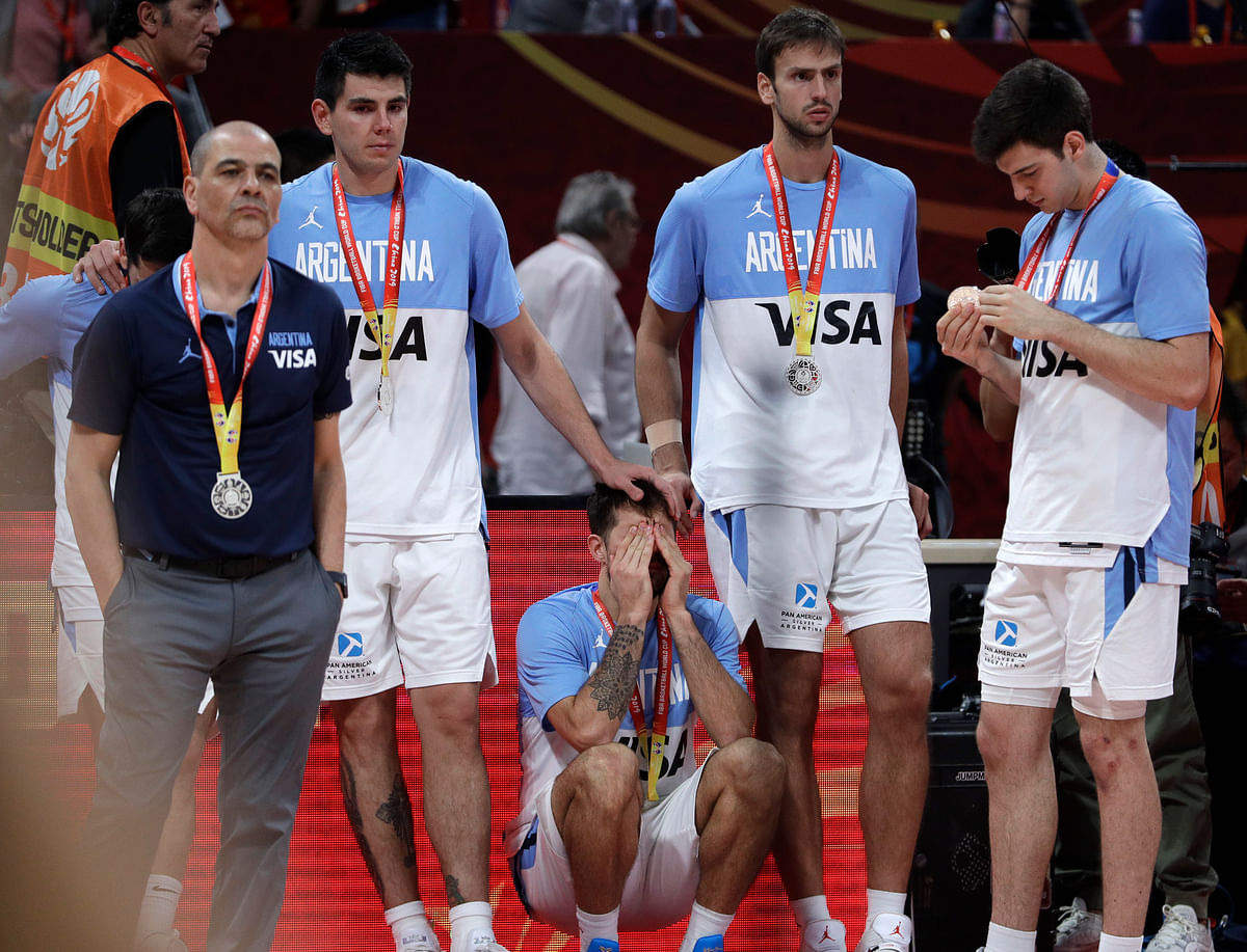Nicolas Laprovittola of Argentina, center, reacts after their loss to Spain in their first-place match in the FIBA Basketball World Cup at the Cadillac Arena in Beijing, Sunday, Sept. 15, 2019.