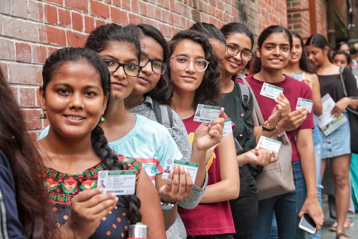 Students queue up with their identity cards to cast their votes for the Delhi University Students Union (DUSU) elections, at Miranda House College in North Campus, New Delhi.