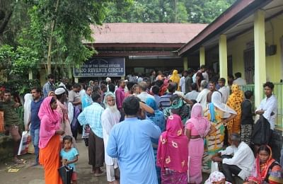 Kamrup: People wait outside the National Register of Citizens (NRC) centre to get their names checked, who were left out in the draft National Register of Citizens (NRC) during an appeal hearing against the non-inclusion of names at an NRC office in Kamrup, Assam on July 23, 2019. (Photo: IANS)