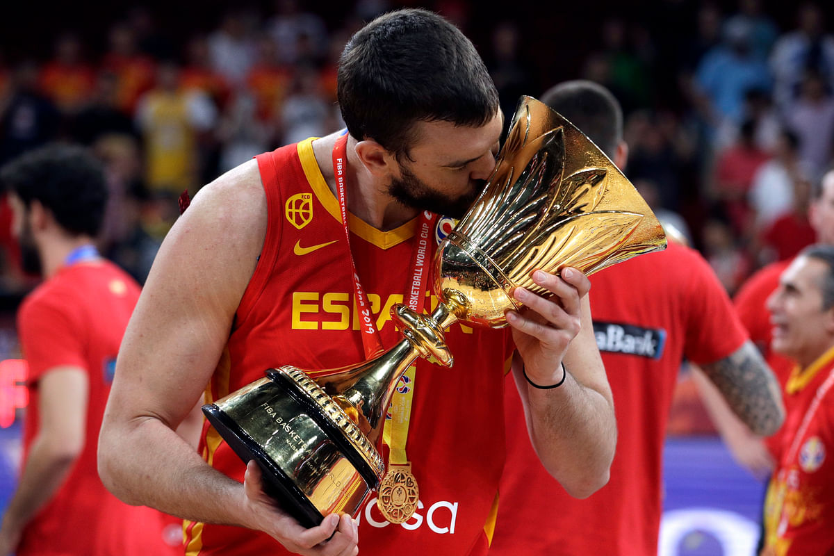 Marc Gasol of Spain celebrates with the Naismith Trophy after they beat Argentina in their first-place match in the FIBA Basketball World Cup at the Cadillac Arena in Beijing, Sunday, Sept. 15, 2019.