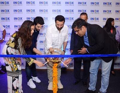 Jalandhar: Actors Sunny Deol, Karan Deol and Sahher Bambba at the launch of a cinema hall in Jalandhar on Sep 14, 2019. (Photo: IANS)