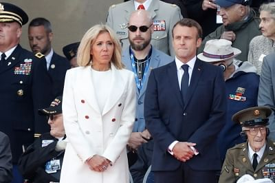 NORMANDY, June 7, 2019 (Xinhua) -- French President Emmanuel Macron (R) and his wife Brigitte Macron attend a ceremony to mark the 75th anniversary of the D-Day landing at the Normandy American Cemetery and Memorial in Colleville-sur-Mer, Normandy, France, June 6, 2019. A commemoration was held on Thursday in Normandy, north France, to mark the 75th anniversary of the D-Day landings against Nazi forces in World War II. (Xinhua/Mao When/IANS)