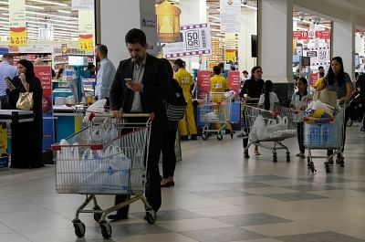 DOHA, June 6, 2017 (Xinhua) -- People buy food at a supermarket in Doha, capital of Qatar, on June 6, 2017. Bahrain, the United Arab Emirates and Yemen joined Saudi Arabia and Egypt in severing relations with gas-rich Qatar, with Riyadh accusing Doha of supporting groups, including some backed by Iran. (Xinhua/Nikku/IANS)