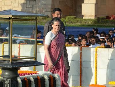 Congress president Sonia Gandhi paying homage to Mahatma Gandhi on his 144th birth anniversary at Rajghat, New Delhi on Oct. 2, 2013. (Photo: IANS)