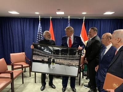 """United Nations: Prime Minister Narendra Modi presents a framed photograph from the """"Howdy Modi"""" event to US President Donald Trump during a meeting on the sidelines of the UNGA74 at United Nations on Sep 24, 2019. (Photo: IANS/PMO)"""