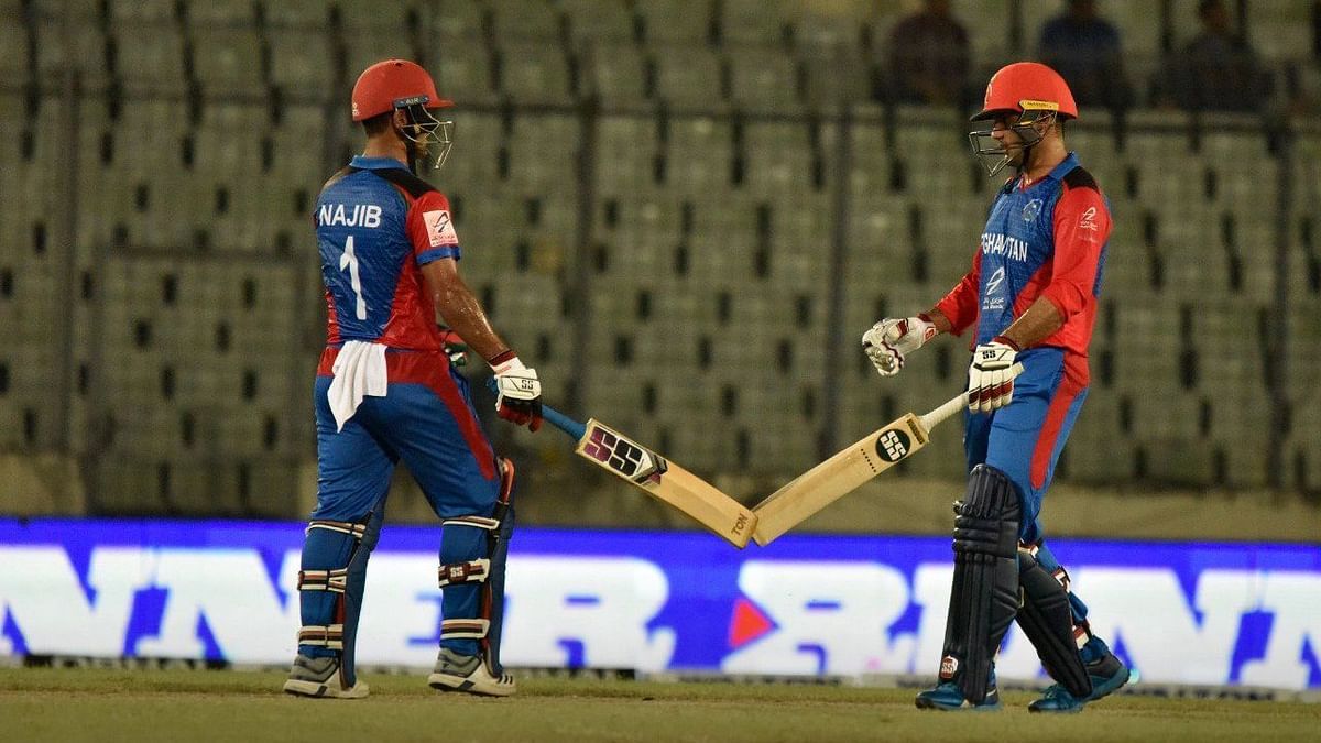 The duo of Nabi (left) and Zadran added 107 runs for the fifth wicket.