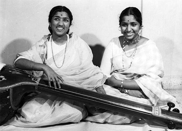 Lata Mangeshkar with Asha Bhosle.