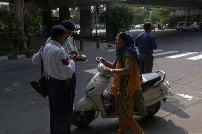 Andhra cops giving helmets, documents instead of challans. (Photo: Sandeep Datta/IANS)