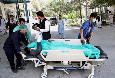 KABUL, Sept. 5, 2019 (Xinhua) -- A wounded person is sent to hospital after a car bomb attack in Kabul, capital of Afghanistan, Sept. 5, 2019. Over a dozen people were killed and injured as a car bomb blast rocked Shash Darak area in the Police District 9 in Kabul on Thursday, a police source said. (Photo by Rahmatullah Alizadah/Xinhua/IANS)