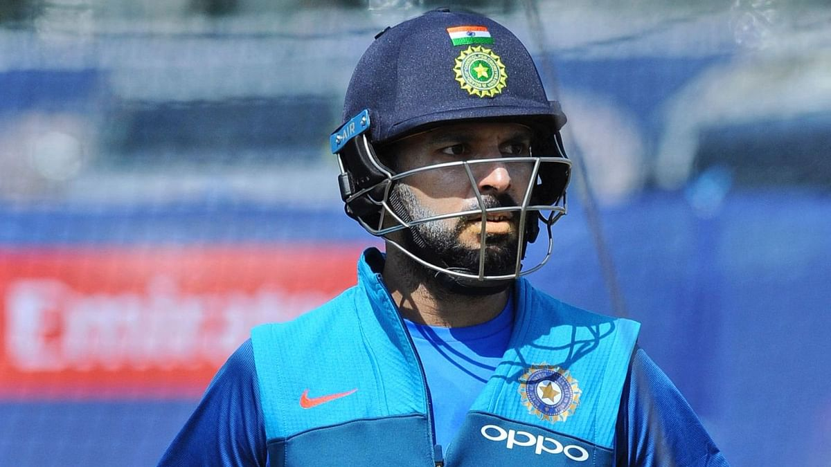 India's Yuvraj Singh arrives to bat in the nets during a practice session ahead of their ICC Champions Trophy Group B match against Pakistan.