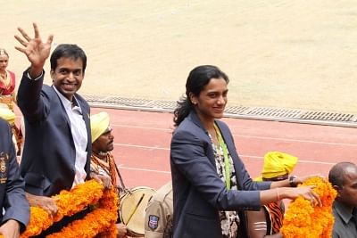 Hyderabad: Indian Badminton team coach Pullela Gopichand and Indian badminton player P.V. Sindhu during a programme organised to felicitate her in Hyderabad on Aug 22, 2016. Sindhu won silver medal in Rio 2016 Olympics. (Photo: IANS)