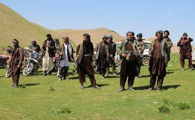 MAZAR-I-SHARIF, April 2, 2017 (Xinhua) -- Armed men attend a surrender ceremony in Chimtal district, Balkh province, Afghanistan, April 1, 2017. More than 200 rebels affiliated with the Taliban group laid down arms and surrendered to the government in the northern Afghan province of Balkh on Saturday, said a provincial source. (Xinhua/Yaqoub Azorda/IANS)