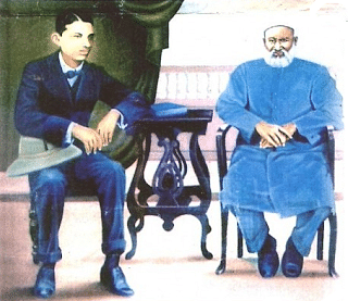 An oil painting of a young MK Gandhi with Dada Abdulla, by Kishorebhat Thanki, now in the Gandhi Smruti Kirti Mandal in Porbandar.