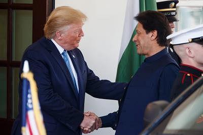 WASHINGTON D.C., July 23, 2019 (Xinhua) -- U.S. President Donald Trump (L) welcomes Pakistani Prime Minister Imran Khan at the White House in Washington D.C. July 22, 2019. (Photo by Ting Shen/Xinhua/IANS)