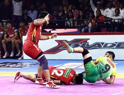 Bengaluru: Players in action during Pro Kabaddi Season 7 match between Bengaluru Bulls and Patna Pirates at Kanteerava Stadium in Bengaluru on Sep 4, 2019. (Photo: IANS)
