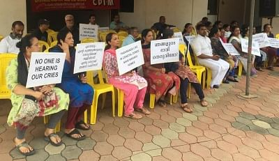 Maradu: Residents of the various flats, which have been ordered to be demolished by the Supreme Court stage a demonstration in front of Holy Faith apartment in Kerala