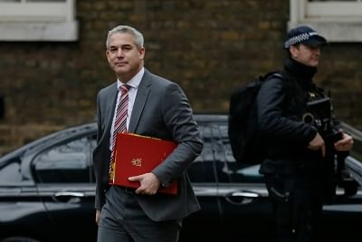 LONDON, Jan. 15, 2019 (Xinhua) -- British Brexit Secretary Stephen Barclay (L) arrives for a cabinet meeting at 10 Downing Street in London, Britain, on Jan. 15. 2019. A delayed parliamentary vote on the Brexit deal is scheduled to take place on Tuesday. (Xinhua/Tim Ireland/Li Muzi)
