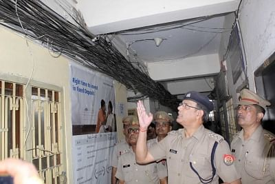 Lucknow Chief fire officer (CFO) Vijay Kumar Singh inspects fire safety norms at a Hazratganj coaching center in the wake of a devastating fire that broke out at a coaching centre in a four-storey building in Gujarat