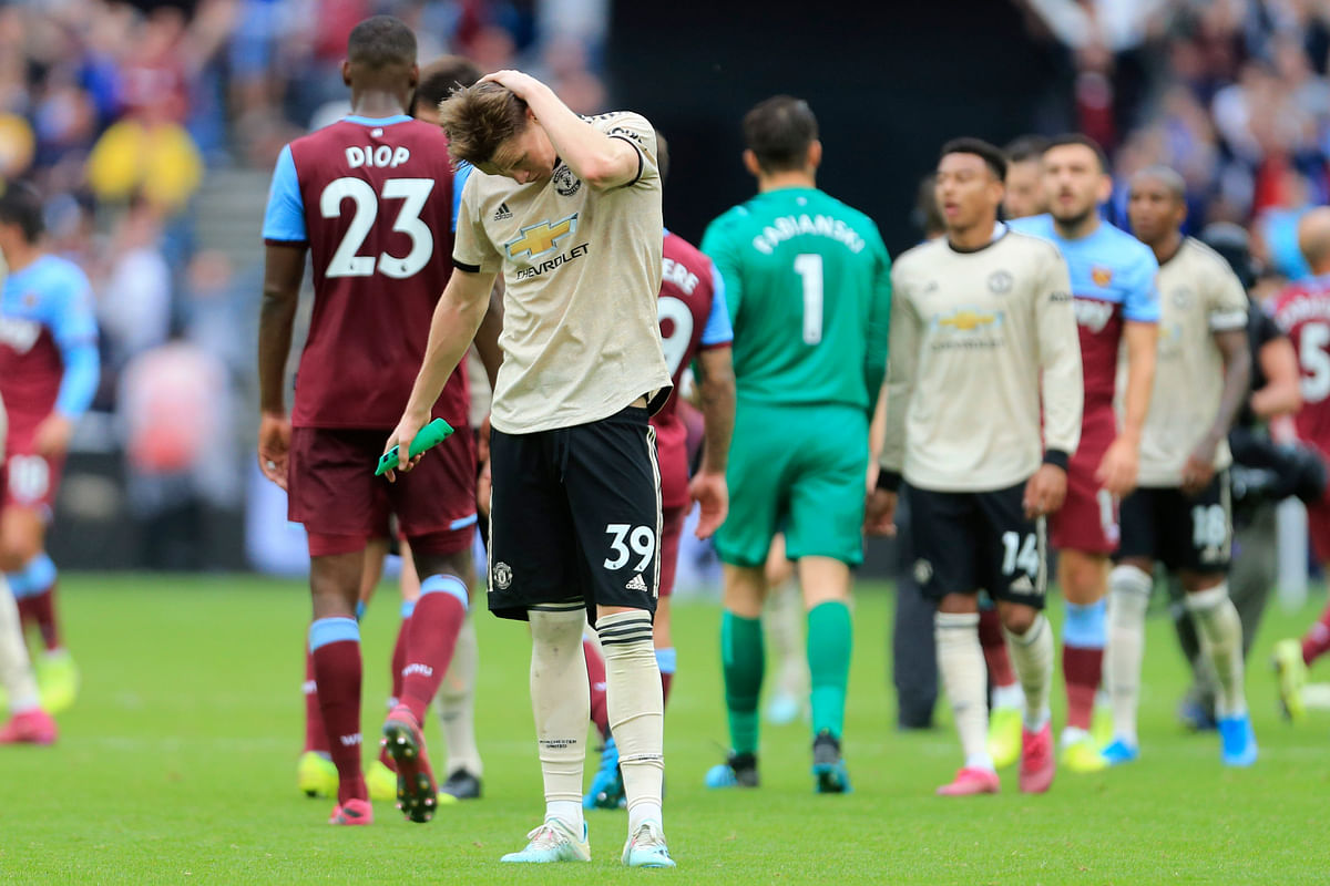 Manchester United's Scott McTominay salutes supporters at at the end of the English Premier League soccer match between West Ham and Manchester United at London stadium in London.