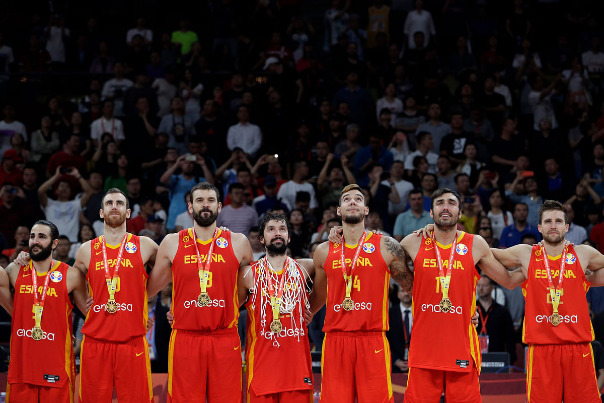 Members of Spain's team stand with their gold medals after beating Argentina in their first-place match in the FIBA Basketball World Cup at the Cadillac Arena in Beijing, Sunday, Sept. 15, 2019.