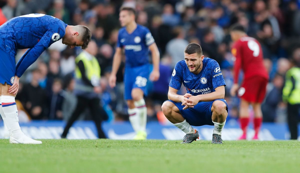 Chelsea's Mateo Kovacic, right, and Mason Mount react at the end of the British Premier League soccer match between Chelsea and Liverpool, at the Stamford Bridge Stadium, London.