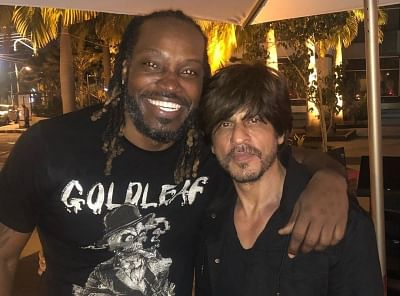 West Indies cricket star Chris Gayle has shared a photograph with Bollywood actor Shah Rukh Khan, who is currently in the Caribbean Islands rooting for Trinbago Knight Riders in the ongoing Caribbean Premier League.