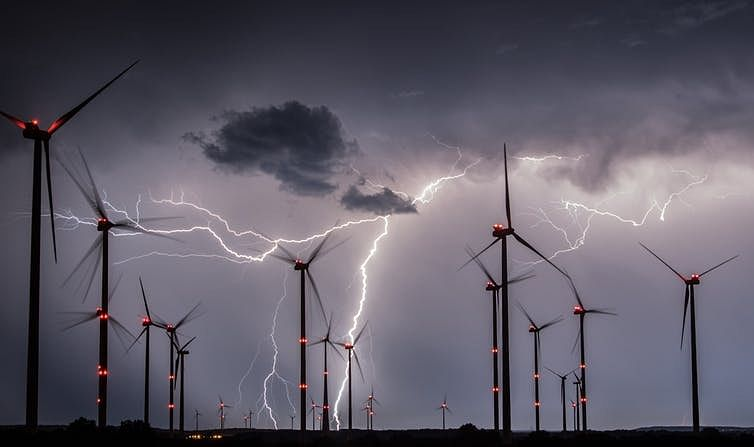 Lightning in the night sky over the Odervorland wind farm near Sieversdorf, Germany.