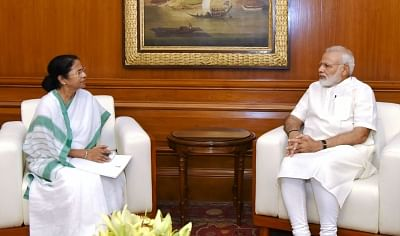 Prime Minister Narendra Modi and West Bengal Chief Minister Mamata Banerjee. (Photo:IANS/PIB)