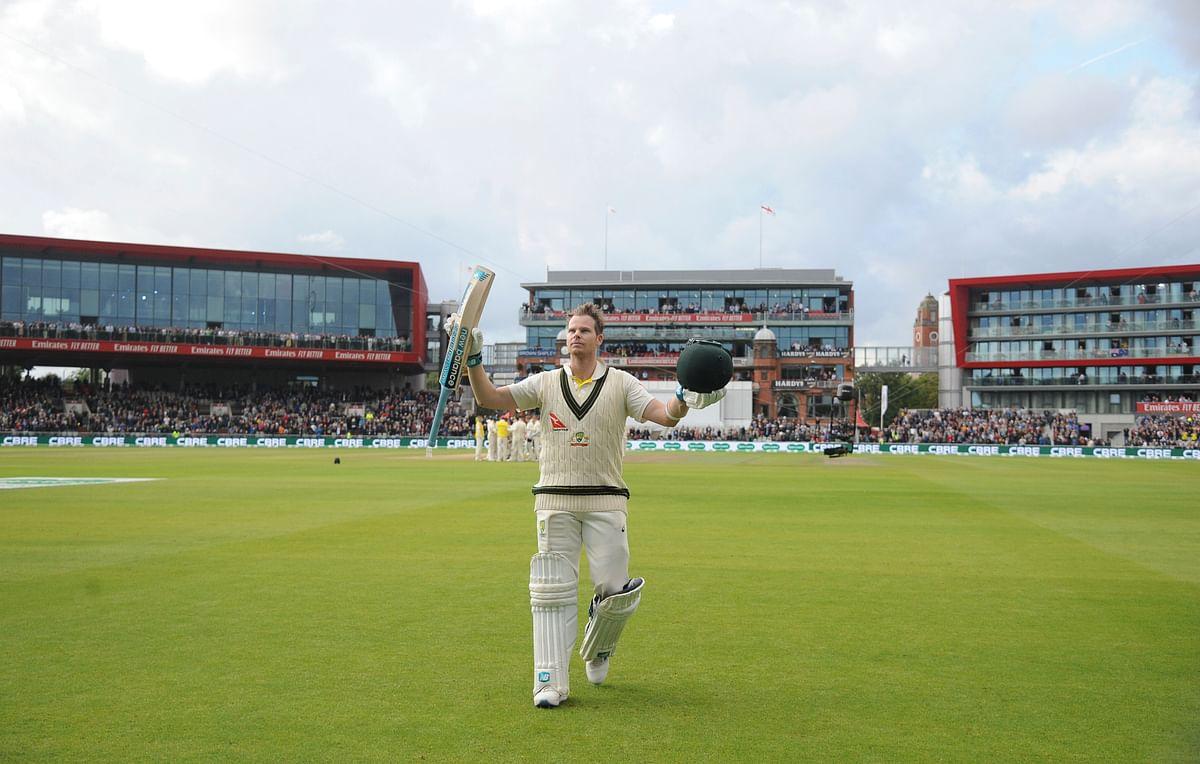 Australia's Steve Smith returns to the pavilion after being dismissed for 211 during day two of the fourth Ashes Test cricket match between England and Australia at Old Trafford in Manchester, England, Thursday Sept 5, 2019.