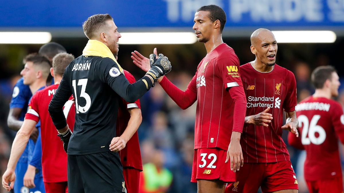 Liverpool goalkeeper Adrian, left, and Joel Matip celebrate their side's 2-1 win at the end of the British Premier League soccer match between Chelsea and Liverpool, at the Stamford Bridge Stadium.