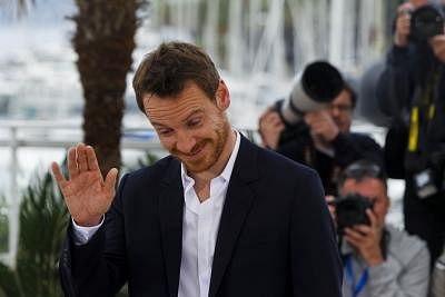 """CANNES, May 23, 2015 (Xinhua) -- Actor Michael Fassbender reacts during the photocall of the film """"Macbeth"""" in competition at the 68th Cannes Film Festival in Cannes, France, on May 21, 2015. (Xinhua/Zhou Lei/IANS) (djj)"""