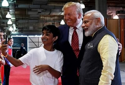 Huston: Prime Minister Narendra Modi and US President Donald Trump pose for a selfie with a kid in Huston on Sep 22, 2019.