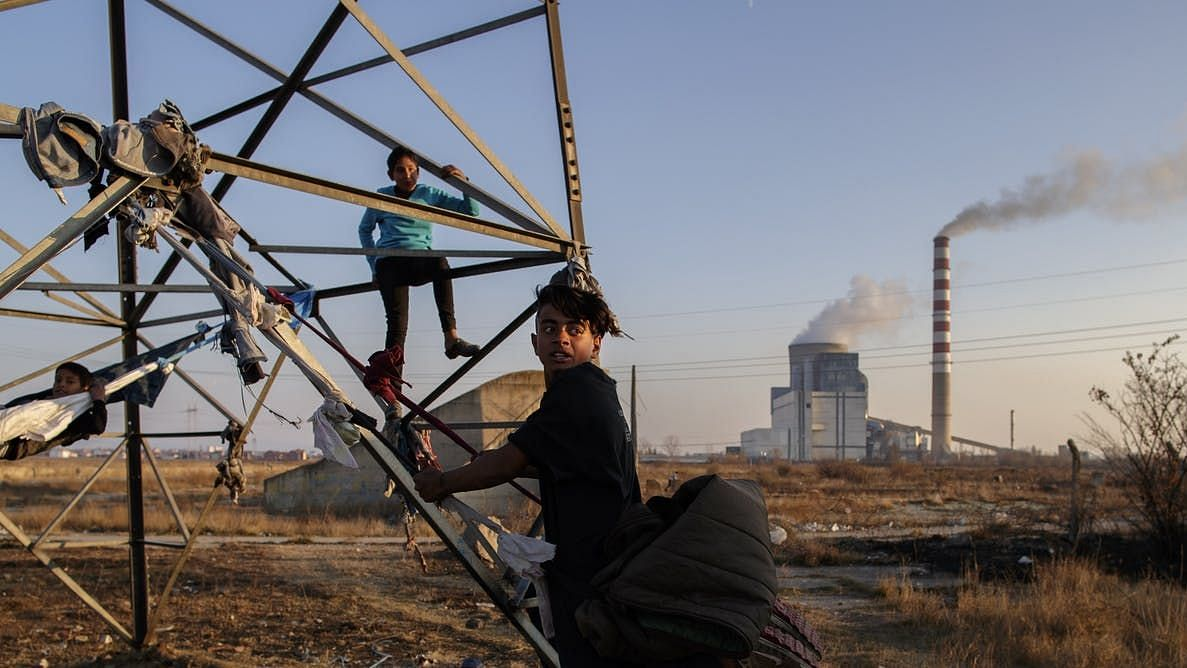 Children playing near a coal-fired power plant in the town of Obilic, Kosovo.