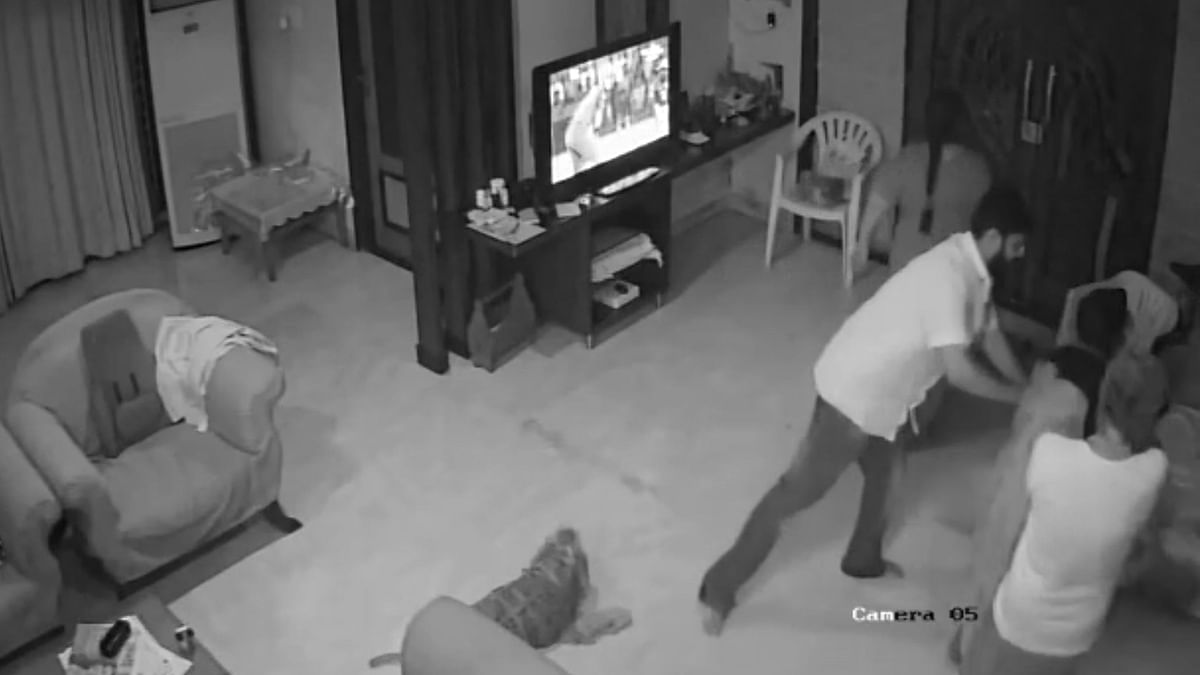 CCTV footage has been released showing a retired High Court judge, his wife and son physically abusing a woman as her two-year-old child tries hard to rescue her mother.