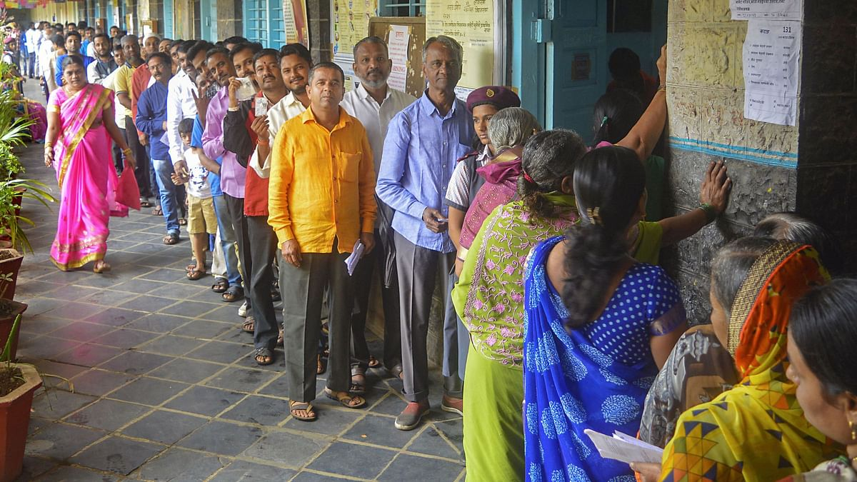 Voters stand in a queue as they wait to cast their votes at a polling station for the Maharashtra Assembly elections. Photo used for representative purposes.